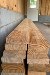 Stack of high quality, dense lumber for framing