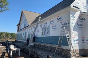 MJM crew installing exterior siding